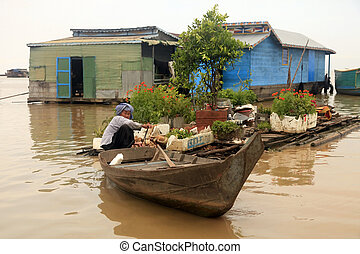 Tonle Sap lake - SIEM REAP, CAMBODIA - APRIL 06, 2014: An...
