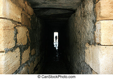 Light in the tunnel - A figure walking out of a dark tunnel...