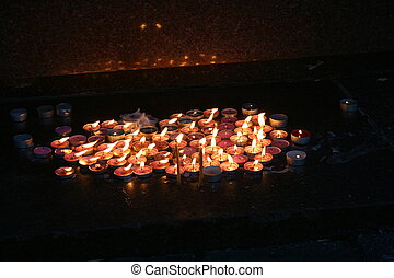 The group lit memorial candles in the dark with reflection...