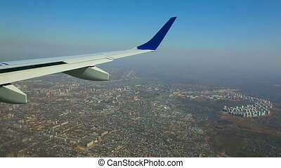 Flying over the city - Aerial view from the cabin porthole...