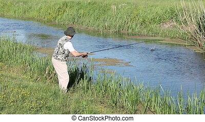 fisherman flying fishing on river