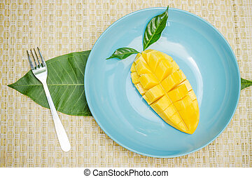 one diced mango in a blue dish
