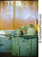 Old military helmet and green wooden box