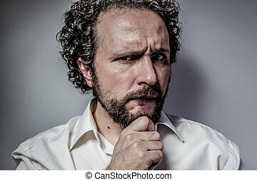 concern for the future, man with intense expression, white shirt