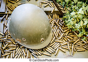 Old military helmet and bullets
