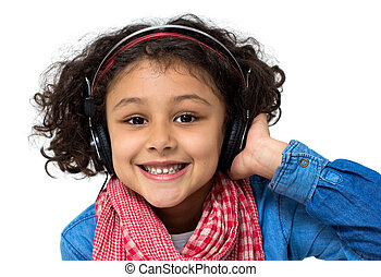 Little girl listening music - Portrait of a little girl...