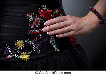 Dress with flower emroidery - Closeup photo of a cocktail...