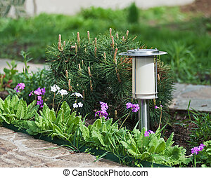 Solar-powered lamp on garden background Selective focus