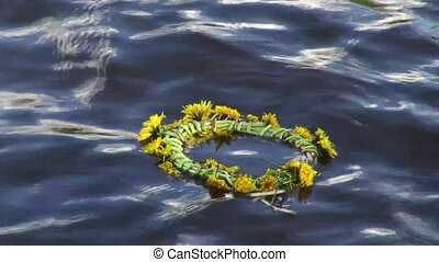 A wreath of flowers on the water