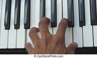 Hand playing Piano chords