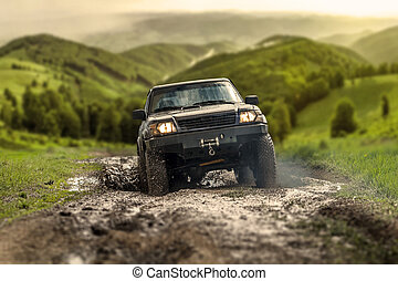 Off road car - Big four by four off road car crossing puddly...