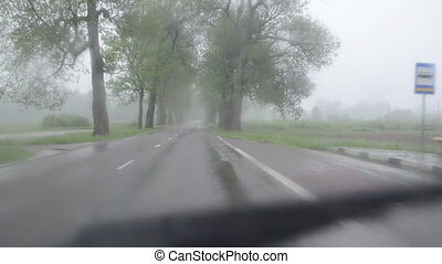 huge rain car windscreen - Strong rain falling on automobile...