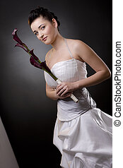 Bride in wedding dress - Studio portrait of a bride posing...