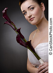Bride portrait - Closeup portrait of a bride posing in a...