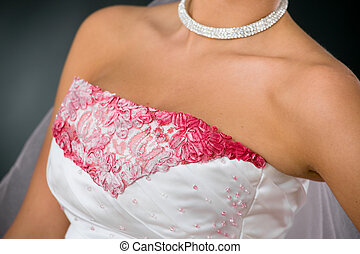 Wedding dress closeup - Closeup photo of wedding dress, with...