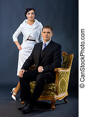 Elegant couple - Portrait of young couple dressed in elegant...