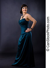 Woman in evening dress - Studio portrait of beautiful young...