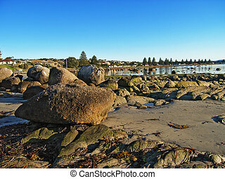 Large rocks at low tide in Victor Harbor, South Australia -...