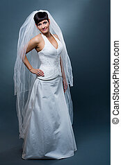 Bride in wedding dress - Full length studio portrait of...