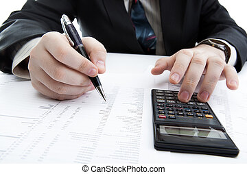 businessman holding a pen and counts the budget on the...