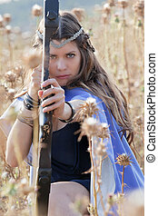 fairytale girl with bow and arrow - fairytale girl shooting...