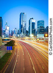Hong Kong modern landmark buildings backgrounds of city highway light trails