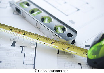 Architect floorplan with level and ruler