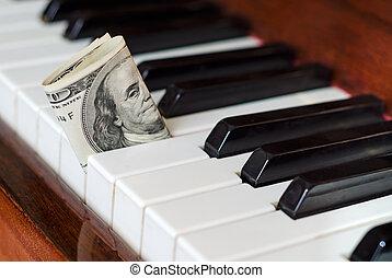 Dollar bill stuck in a piano - One hundred dollar bill stuck...