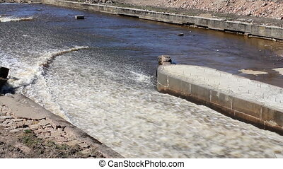 protective dam dumps water on the river - engineering object...