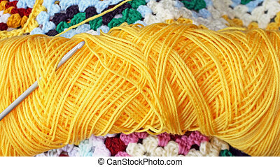 Wool - Bright yellow skein of yarn with crochet hook -...