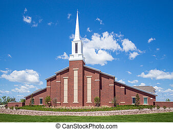 Mormon church against blue sky with white clouds