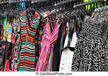 Shopping for dresses - Colorful dresses at a market stall....