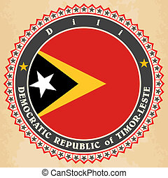 Vintage label cards of East Timor flag. Vector illustration