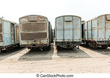 Grey cargo train carriage in train yard, taken on a sunny...