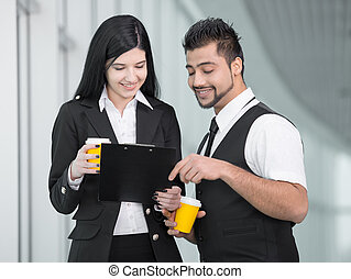 Business People - Confident businesswoman and businessman...