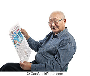 Asia man reads newspaper - mature man reads newspaper...