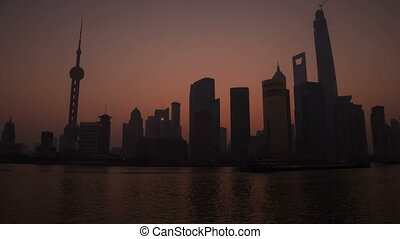 Sunrise in Shanghai - Pudong view on the Bund embankment in...