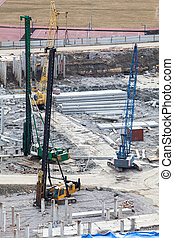 Construction site with machinery for piling into the ground