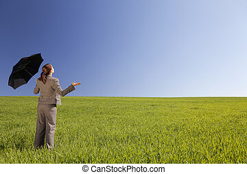 Business Concept Woman In A Green Field With An Umbrella