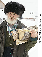 manual labour - the elderly habitant of Russian village...