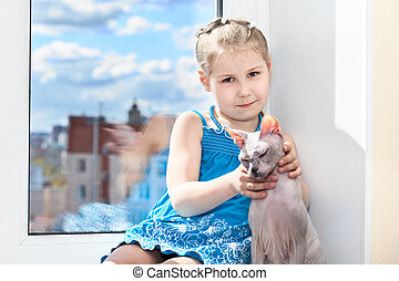 Young girl sitting with cat on window sill