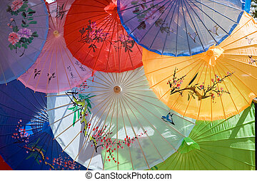 Chinese Umbrellas - the sun shines through colorful Chinese...