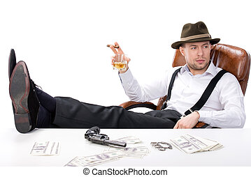 Gangster - gangster sitting at a table counting money. on...
