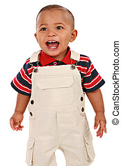 Happy Smiling 1-year old baby boy standing with mouth open...