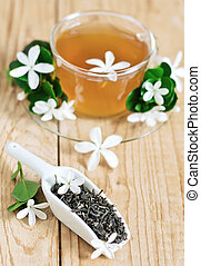 Jasmine tea - Green tea with jasmine blossom in cup and...