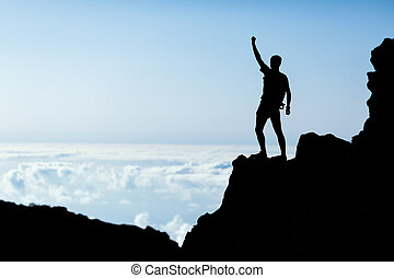 Hiking success silhouette, man trail runner in mountains -...