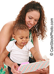 Mother and Baby Boy Reading Book Together - Smiling Mother...
