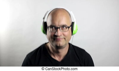 Listen to the music - Funny balding man with headphones...