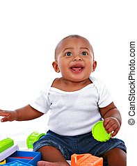 7-month old baby playing with toys