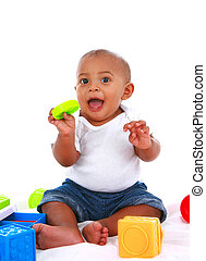 7-month old baby playing with toys on white background